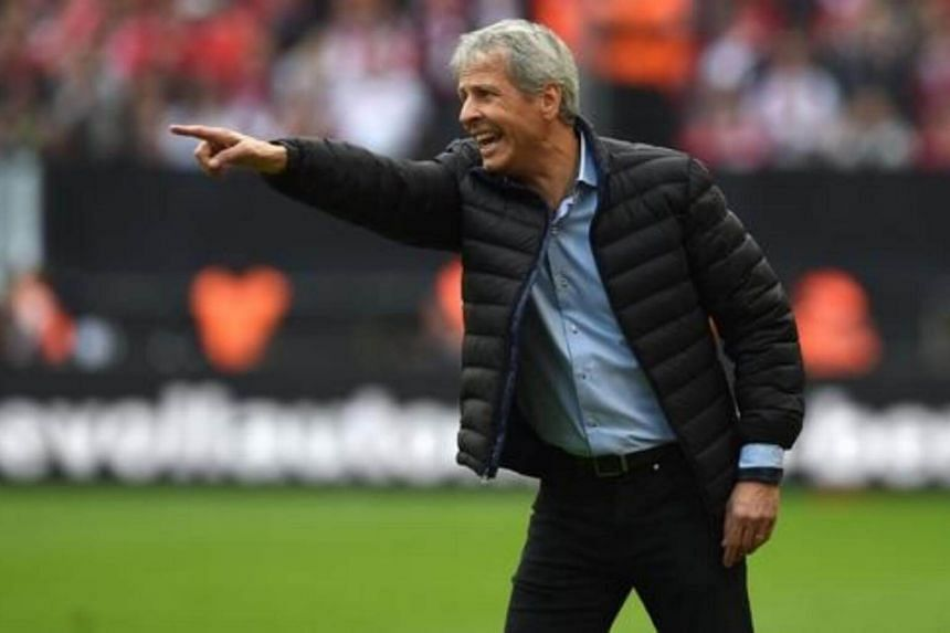 Moenchengladbach's Swiss head coach Lucien Favre reacts during the German first division Bundesliga football match in Cologne, western Germany on Sept 19, 2015.
