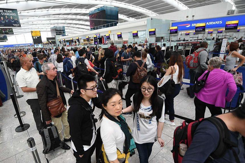 British Airways passengers wait at the Heathrow Airport in London, Britain, on May 29, 2017.