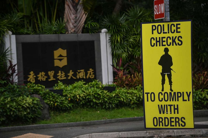 A cautionary sign is seen outside Shangri-La Hotel before the start of the IISS Shangri-La Dialogue, on 1 June, 2017.
