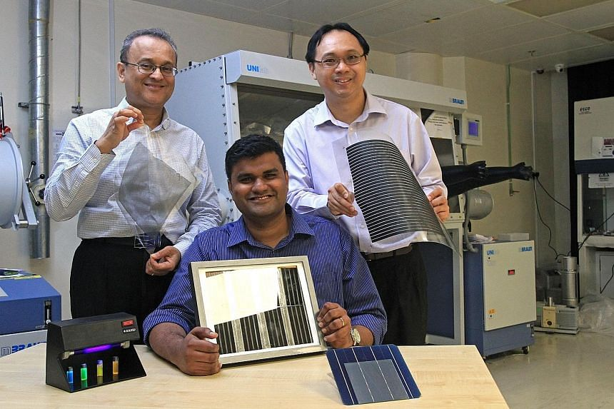(From left) Professor Subodh Mhaisalkar, Assistant Professor Nripan Mathews and Associate Professor Sum Tze Chien, whose research shows the material perovskite can be printed onto glass or plastic sheets.