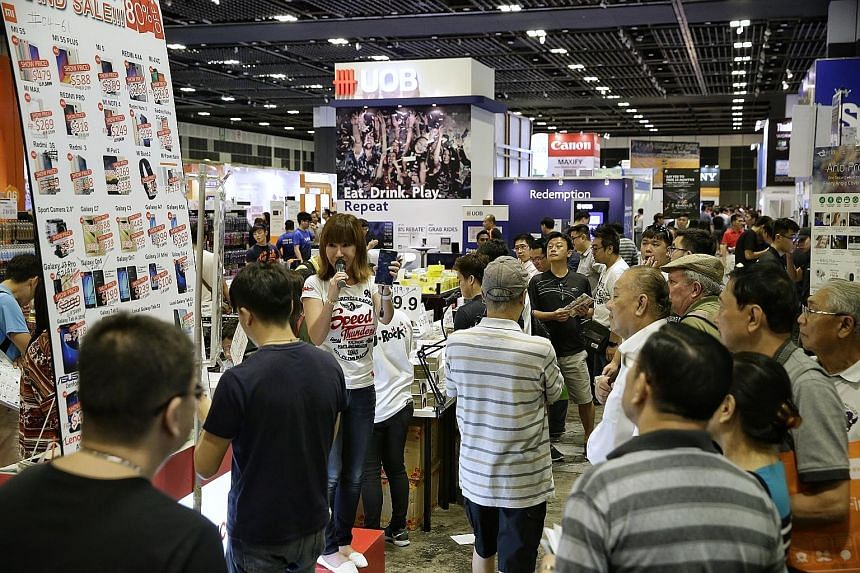 About 50,000 visitors flocked to the opening of this year's Consumer Electronics Exhibition, spread over three floors at Suntec Singapore, yesterday. Now in its fourth year, the exhibition offers discounts and promotions from top tech brands and telc