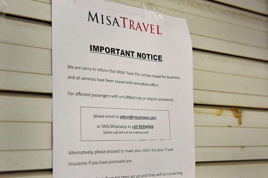 Misa Travel's office at Hong Lim Complex was shut yesterday. A notice put up on the shutters (far right) says the company is no longer in business.