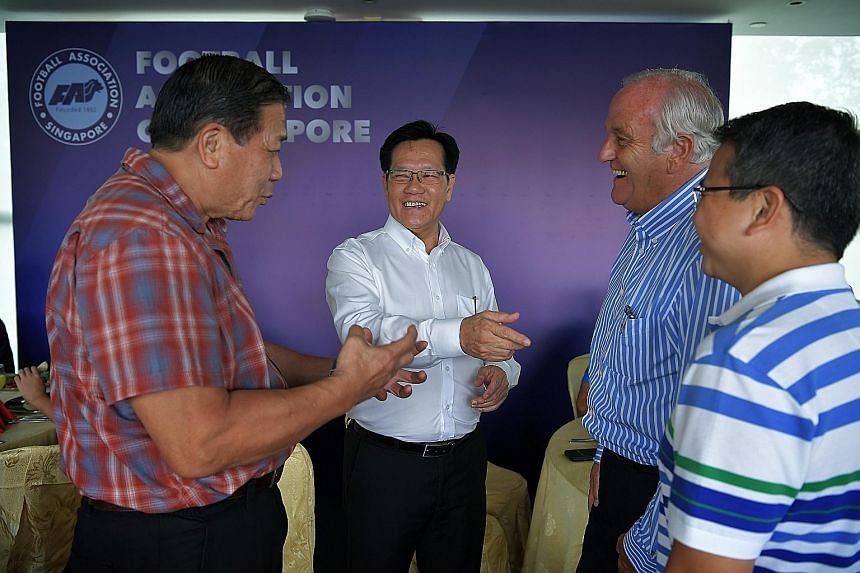 New FAS president Lim Kia Tong (white shirt) meeting staff for lunch at Jalan Besar Stadium on his first day of work on May 2. He had pledged that his team would work hard to heal Singapore football.