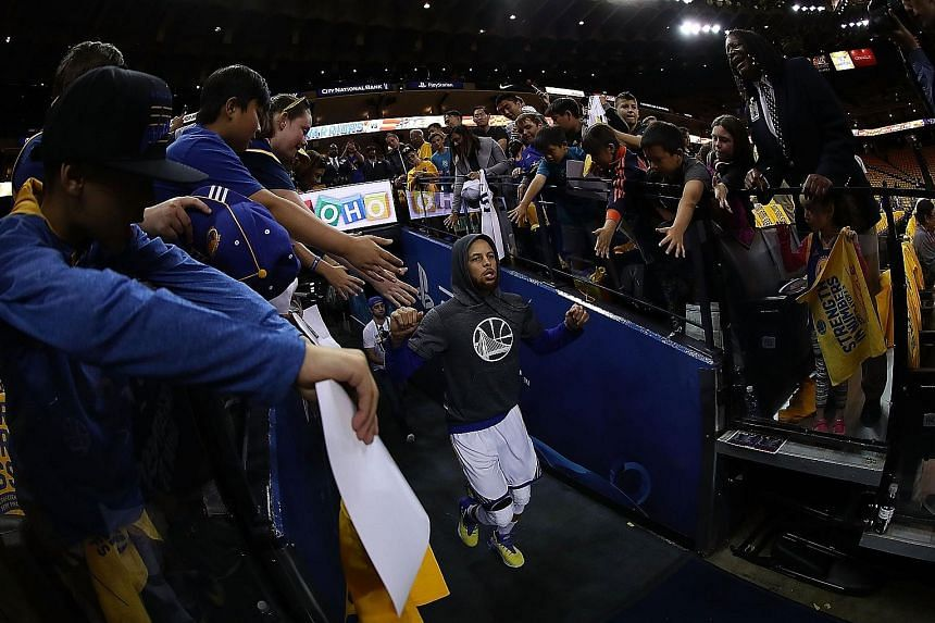 Stephen Curry of the Golden State Warriors running out of the tunnel at Oracle Arena, the scene of last year's late collapse against the Cleveland Cavaliers, during the conference semi-finals. The Warriors have reached the Finals with a perfect 12-0