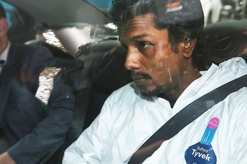 "Manodh Marks, who was arrested for threatening to blow up the MAS plane he was on, being taken to a Melbourne court yesterday. A police officer on MAS Flight MH128 after a passenger shouted that he wanted to ""blow the plane up"". The man was restraine"
