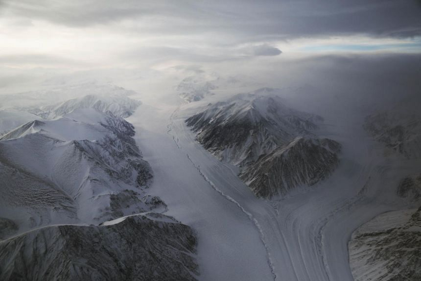 A section of a glacier is seen from Nasa's Operation IceBridge research aircraft on March 29, 2017 above Ellesmere Island, Canada.