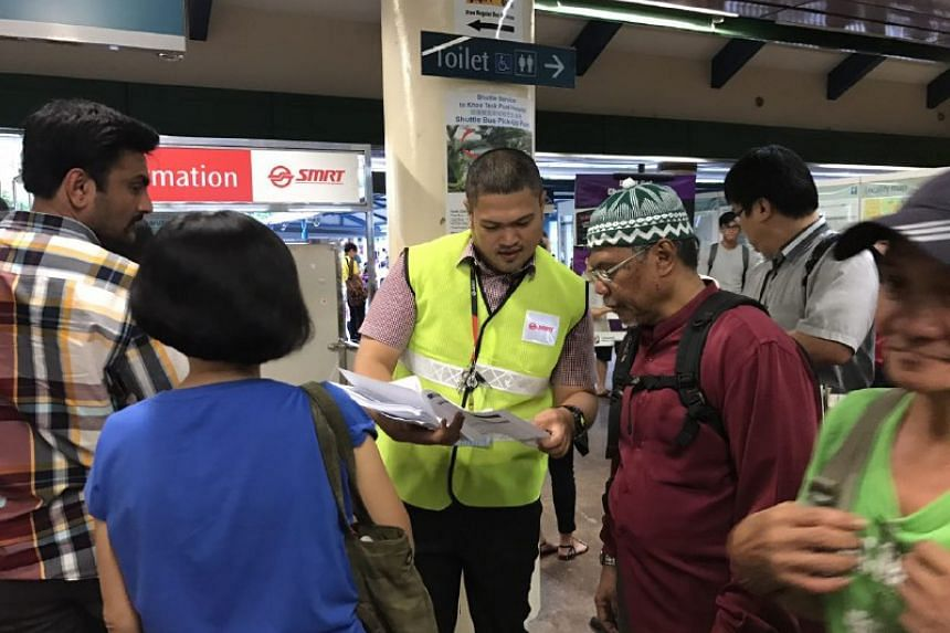Staff giving out pamphlets to advise passengers on the alternative modes of transport available.