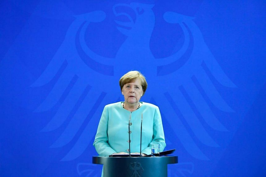 """German Chancellor Angela Merkel giving a statement where she pledged """"more decisive action than ever"""" on climate on June 2, 2017 at the Chancellery in Berlin, in reaction of the US President's decision to quit the Paris climate agreement."""