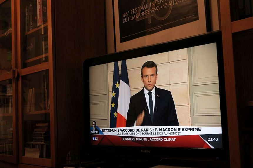 French President Emmanuel Macron, seen on all news channel LCI, speaks from the Elysee Palace in Paris, France, after US President Donald Trump announced his decision.