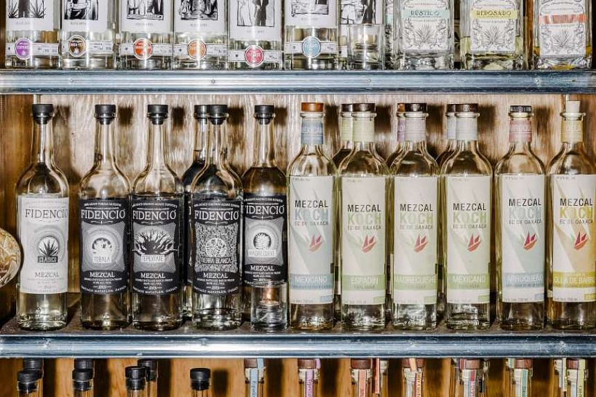 A selection of mezcals behind the bar at Mezcaleria Las Flores in Chicago. PHOTO: NYTIMES