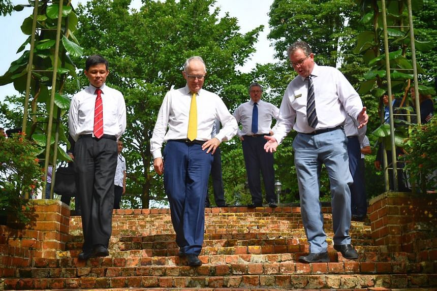 Mr Chan Chun Sing, Australian Prime Minister Malcolm Turnbull and Singapore Botanic Gardens' director Dr Nigel Taylor walking down the Prisoner-of-War brick steps.