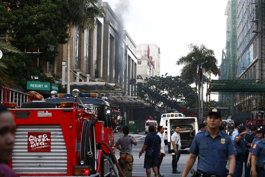 Smoke coming out of a broken window of the Resorts World Manila hotel and casino complex in Pasay City, south of Manila, on June 2, 2017.