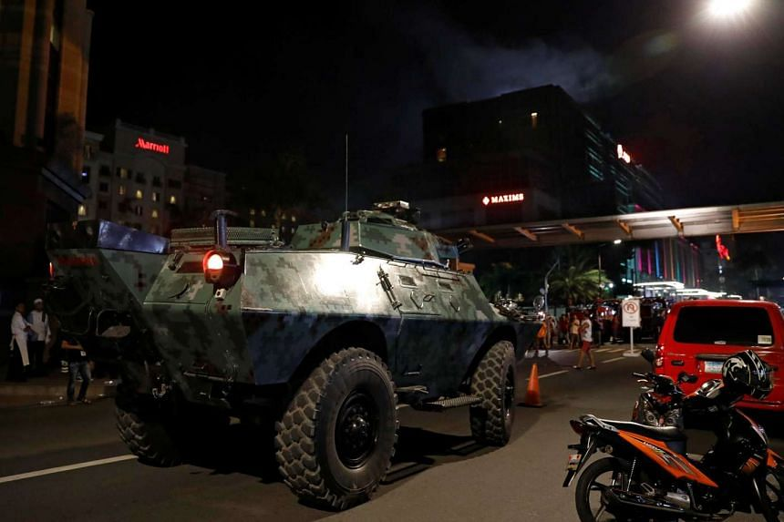 An armoured fighting vehicle (AFV) arrives near the Resorts World Manila after gunshots and explosions were heard in Pasay City, on June 2, 2017.