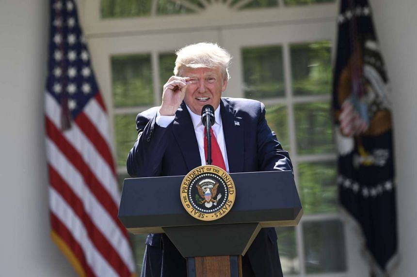 US President Donald Trump announces his decision to withdraw the US from the Paris Climate Accords in the Rose Garden of the White House.