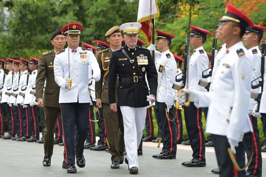 GEN Dunford inspecting the Guard of Honour contingent at the Istana.