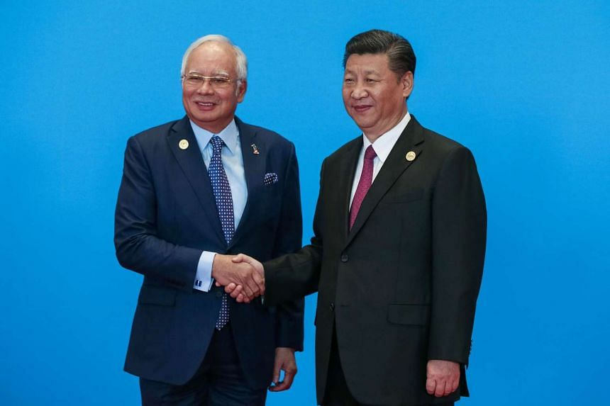 Malaysia's Prime Minister Najib Razak shakes hands with China's President Xi Jinping during the welcome ceremony for the Belt and Road Forum, at the International Conference Center in Yanqi Lake, north of Beijing, on May 15, 2017.