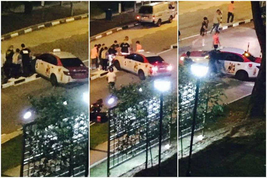 Passers-by helped shift a cab that was stuck on a road divider along Choa Chu Kang Avenue 5 on Friday night.
