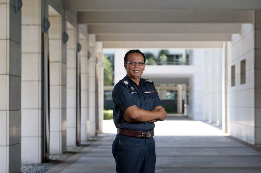 Senior Staff Sergeant Mohamad Ismail Yahaya, 48, a CISCO security officer, receives a Commendation Award at the Commissioner of Police's Commendation Ceremony.
