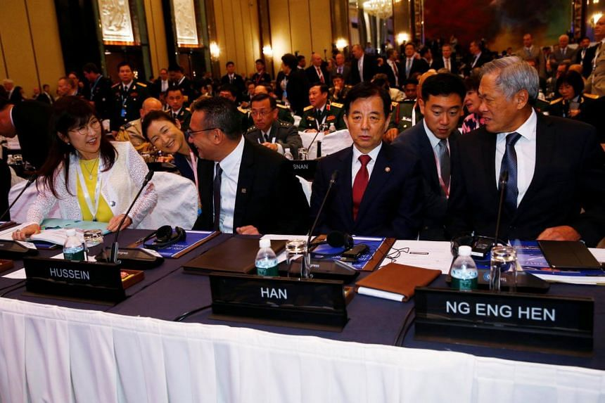 (Left to right) Japan's Defence Minister Tomomi Inada, Malaysia's Defence Minister Hishammuddin Hussein, South Korea's Defence Minister Han Min Koo and Singapore's Defence Minister Ng Eng Hen take their seats at the 16th IISS Shangri-La Dialogue in S