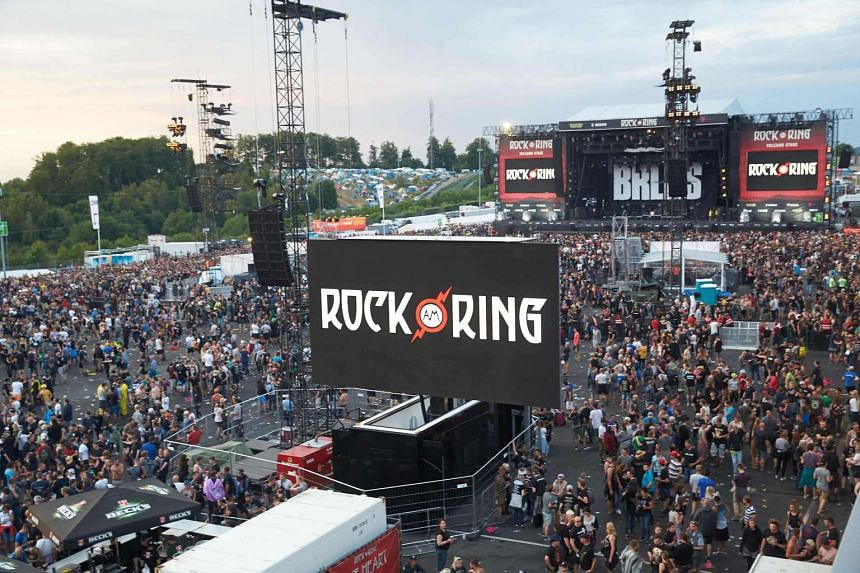 Festival goers leave the venue of the Rock am Ring music festiva in Nuerburg on June 2, 2017 following an evcuation alert amid a possible 'terrorist threat'.