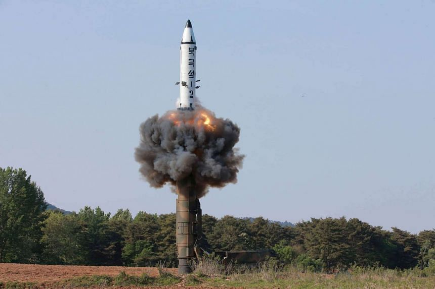 The scene of the intermediate-range ballistic missile Pukguksong-2's launch test in this undated photo released by North Korea's Korean Central News Agency (KCNA) on May 22, 2017.