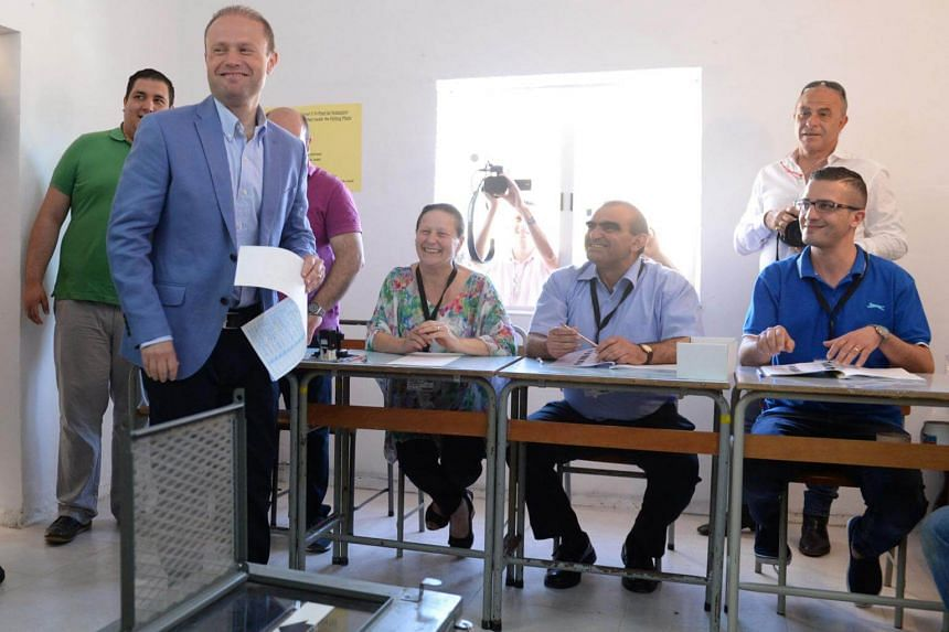 Malta's Prime Minister Joseph Muscat prepares to cast his vote at a polling station in his home town of Burmarrad on June 3, 2017.
