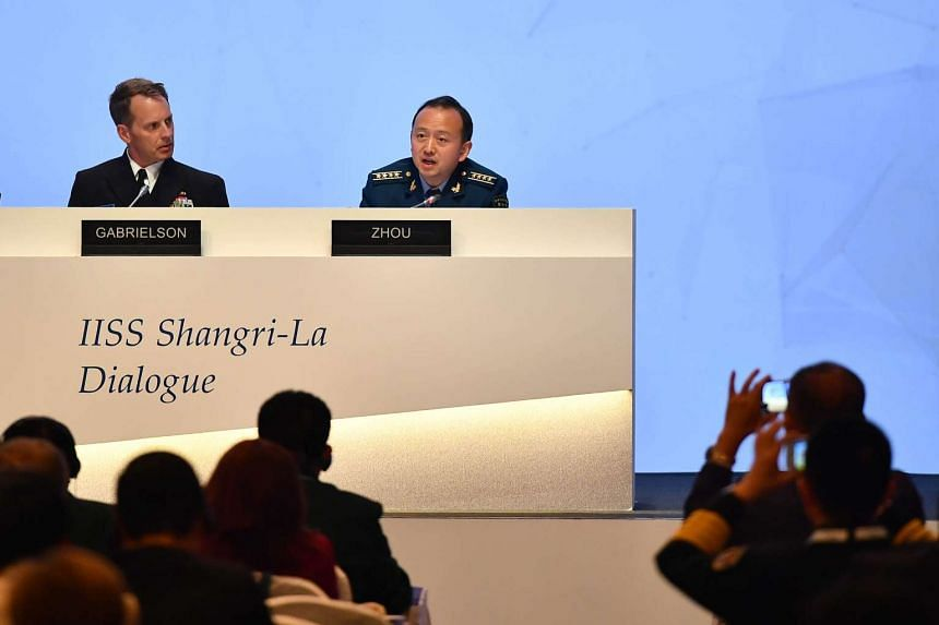 Rear Admiral Donald D Gabrielson and Senior Colonel Zhou Bo of the People's Liberation Army at IISS Shangri-La Dialogue 2017 on June 3, 2017.