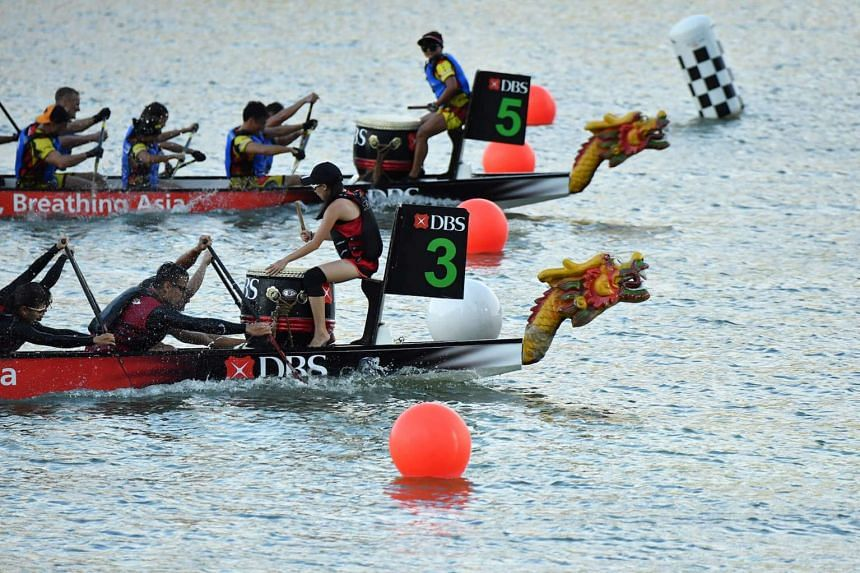 DBS Asia Dragons, in boat 3, edging out Hong Kong Disneyland Team Mushu Gold to win the corporate mixed race during day three of the DBS Marina Regatta 2017 on June 3.