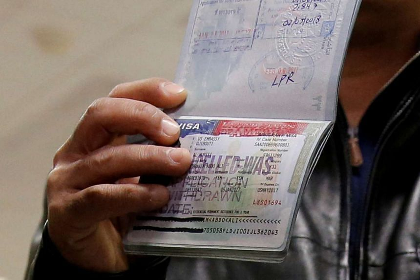 A cancelled visa in the passport of a family trying to enter the US amid the travel ban earlier this year.
