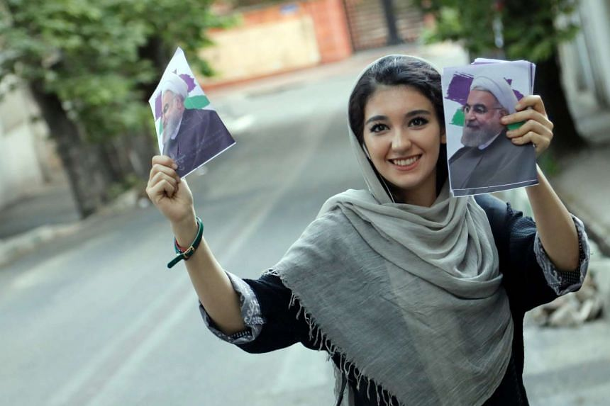 A female supporter of pragmatist president Hassan Rouhan, who championed the nuclear deal.