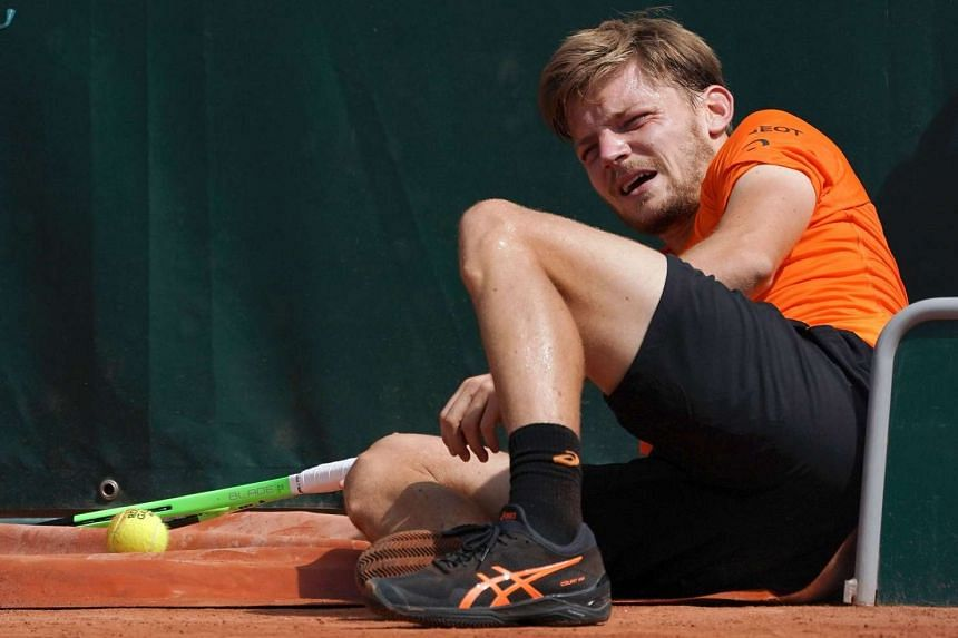 Goffin hurt his ankle when he got caught up in court covers.