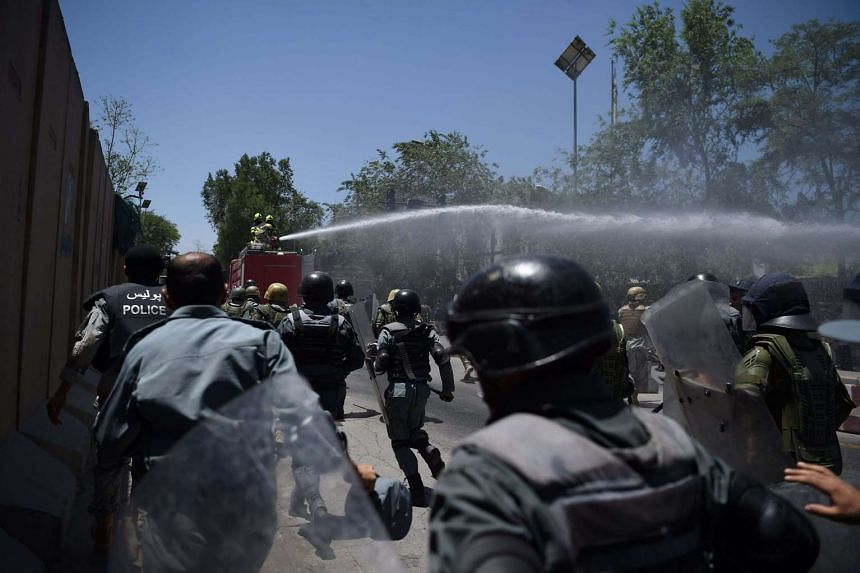 Afghan security forces use water canons to disperse protesters during clashes at a protest against the government following a catastrophic truck bomb attack near Zanbaq Square in Kabul on June 2, 2017.