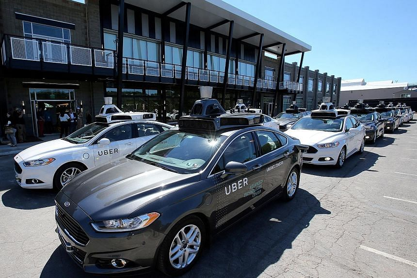 A fleet of Uber's Ford Fusion self-driving cars during a demonstration of self-driving automotive technology in Pittsburgh, Pennsylvania, in September last year.