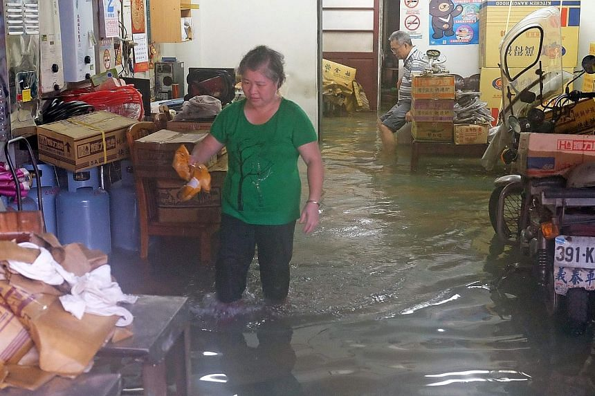 One of the many homes deluged by flood waters in Jinshan district in New Taipei City yesterday after torrential rain swept through the island.