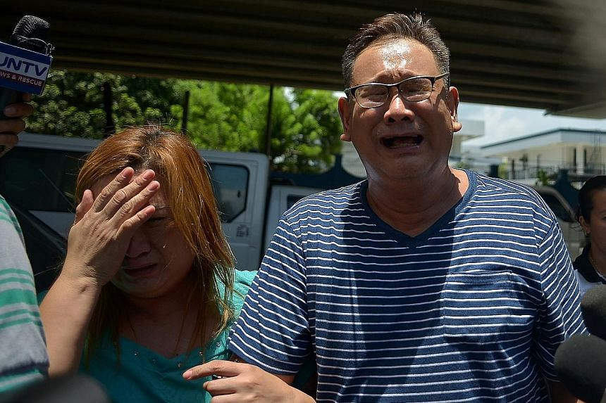 Relatives of one of the 36 victims who died are left distraught yesterday in the wake of the attack at the Resorts World Manila.