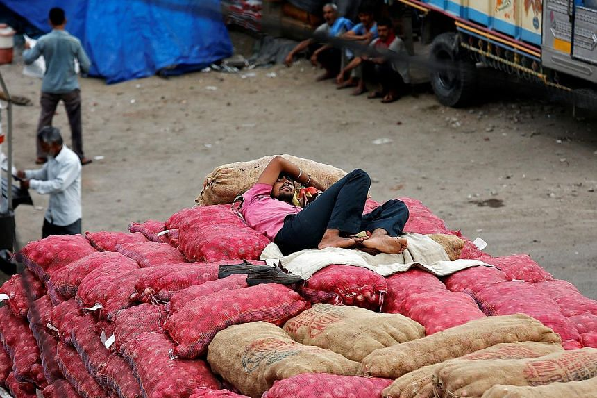 A truck driver with his cargo of onions at a wholesale market in Jammu. India's export market has been sliding over the past three years.