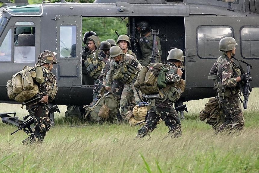 Filipino soldiers in Marawi City, Mindanao, yesterday. So far, 39 soldiers, 120 militants and 19 civilians have been killed in the 11 days of fighting in the city.