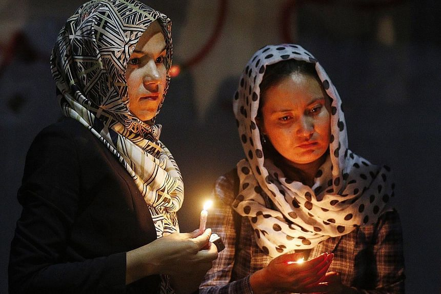 Civil society activists at a memorial on Thursday for the victims of the bomb attack in Kabul. The Afghan government and foreign missions in Kabul have been preparing for a conference next Tuesday as part of a move towards peace negotiations with the