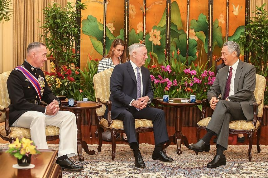 US General Joseph Dunford, chairman of the Joint Chiefs of Staff, and US Defence Secretary Jim Mattis meeting Prime Minister Lee Hsien Loong at the Istana yesterday. Gen Dunford was also awarded Singapore's highest military honour by President Tony T