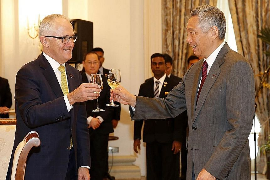 Australian Prime Minister Malcolm Turnbull and Prime Minister Lee Hsien Loong toasting to the enduring friendship between their countries at the Istana, where Mr Lee hosted a lunch for Mr Turnbull. The Australian leader is in Singapore on a three-day
