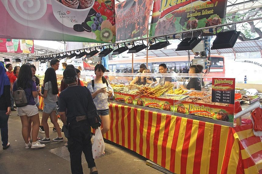 It costs between $16,000 and $20,000 to rent a stall at the Geylang Serai Bazaar. One stall owner says illegal workers are paid $40 to $80 a day, whereas locals are paid $80 to $100 a day.