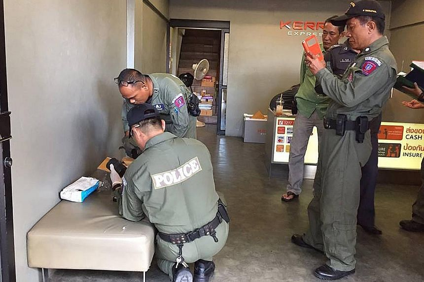 """Police dispatched an Explosive Ordnance Disposal team to the shop (left) and found the grenades wrapped in black plastic tape inside the box (above). The grenades were """"live"""" and had a kill zone of 5m and casualty radius of up to 15m."""
