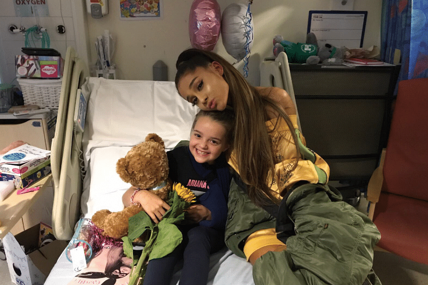 Ariana Grande visiting eight-year-old Lily Harrison who had a shrapnel wound from the Manchester Arena attack.
