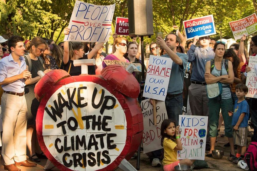 Protesters at a demonstration in front of the White House in Washington, DC, objecting to US President Trump's decision to withdraw from the Paris Climate accord.