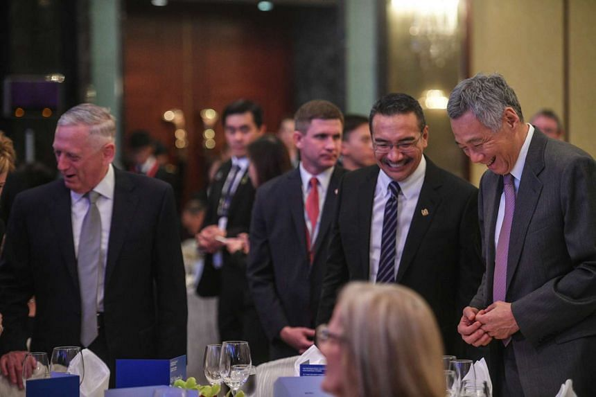 (From left) US Defence Secretary James Mattis, Malaysian Defence Minister Hishammuddin Hussein and Prime Minister Lee Hsien Loong pictured before the keynote speech.