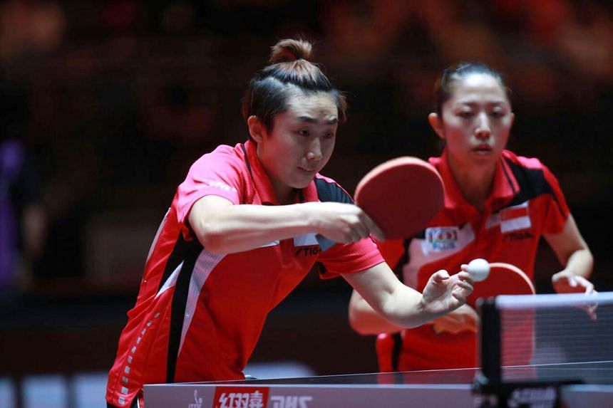 Feng Tianwei (left) and Yu Mengyu guaranteed Singapore a medal at the World Table Tennis Championships in Dusseldorf after beating Chinese Taipei's Cheng I-ching and Chen Szu-yu.