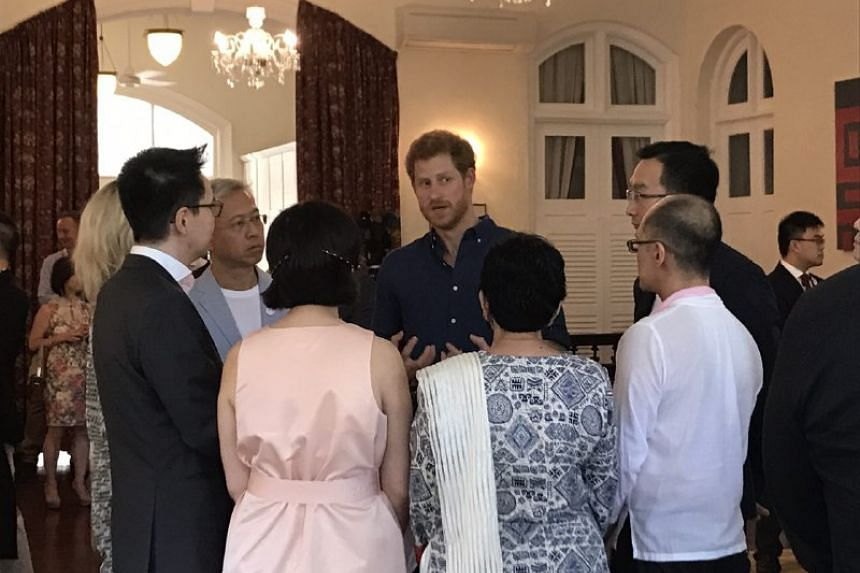Prince Harry speaking with Action For Aids staff and volunteers at Eden Hall.