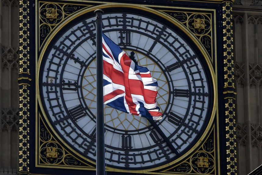 A Union flag flies in front of Big Ben over the Houses of Parliament in central London.