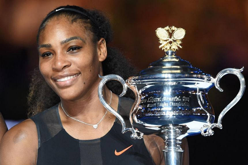 Serena Williams holding the trophy following her victory at the Australian Open on Jan 28.
