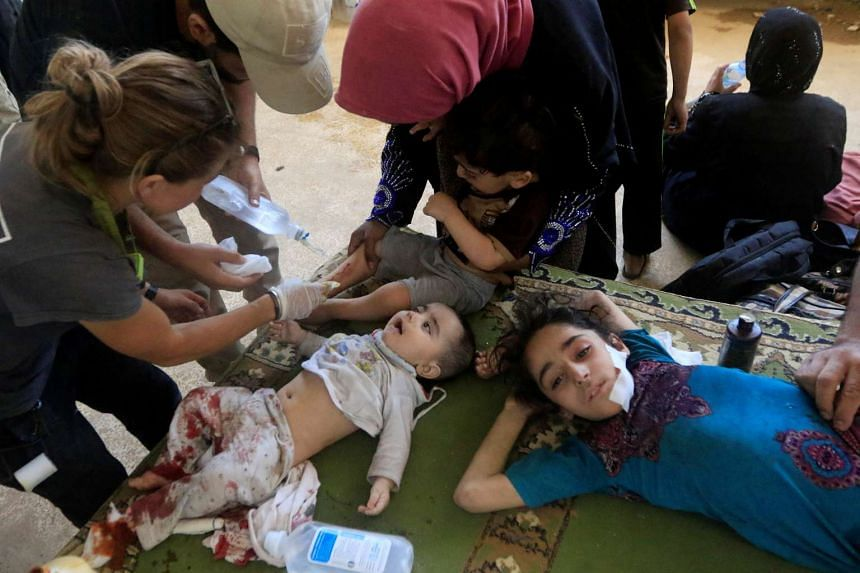 Displaced and wounded Iraqi children get treatment in western Mosul, June 3, 2017.